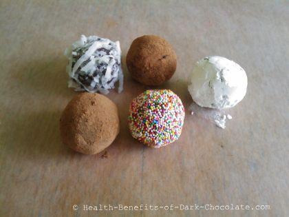 Homemade dark chocolate truffles with various coatings.
