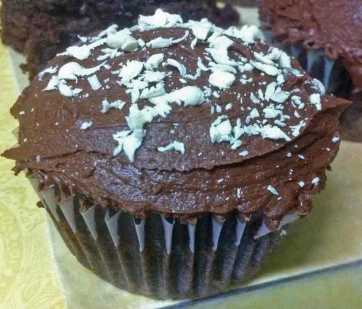 A death by chocolate cupcake topped with grated white chocolate.