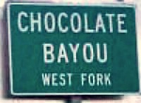Chocolate Bayou highway sign with a chocolate name on it.