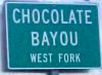 Photo of the Chocolate Bayou sign on Highway 288 near Houston, Texas.