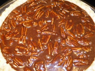 Chocolate pecan pie ready for the oven.