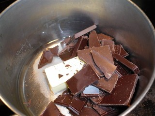 Chocolate pieces, butter and water in a pan.