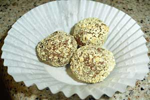 Chocolate balls covered in crushed graham crackers.