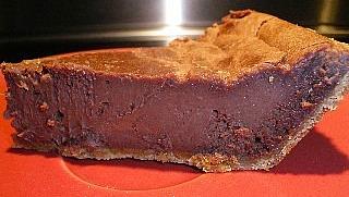 Slice of chocolate cheesecake.