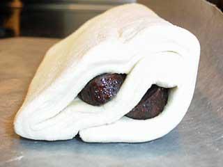 Frozen chocolate filled croissant dough